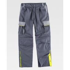 Calça tricolor com reforços, abertura nas perneiras e debrum de alta visibilidade